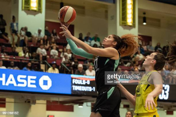 New York Liberty center Amanda Zahui B drives to the basket during the second half of the WNBA basketball game between the Seattle Storm and New York...
