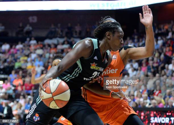 New York Liberty Center Tina Charles drives the baseline while Connecticut Sun Forward Alyssa Thomas defends during the game as the Connecticut Sun...