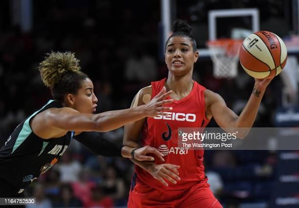 New York Liberty guard Bria Hartley defends as Washington Mystics guard Natasha Cloud passes the ball during the second half of the game between the...