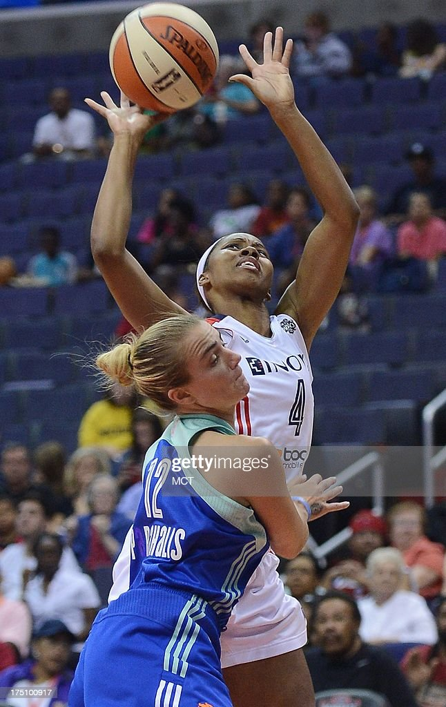 New York Liberty guard Samantha Prahalis (12) fouls Washington Mystics guard Tayler Hill (4) as she drives to the basket in the third quarter at the Verizon Center in Washington, D.C., Wednesday, July 31, 2013, The Liberty defeated the Mystics, 88-78.