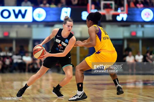 New York Liberty's guard Marine Johannes handles the ball next to Los Angeles's Tierra Ruffin-Pratt during the WNBA match New York Liberty against...