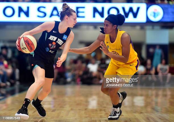 New York Liberty's guard Marine Johannes handles the ball next to Los Angeles's Nneka Ogwumike during the WNBA match New York Liberty against Los...