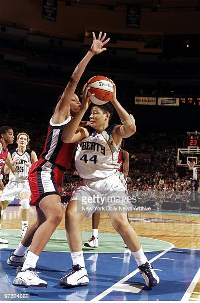 New York Liberty's Tari Phillips tries to get around the Houston Comets' Tina Thompson in action at Madison Square Garden The Liberty won the game...