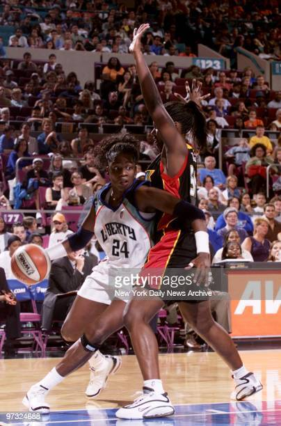 New York Liberty's Tari Phillips works her way around the Detroit Shock's Barbara Farris at Madison Square Garden The Liberty rallied to nip the...