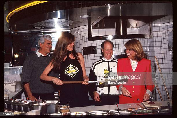 New York Lieutenant Governor Betsy McCaughey and model Carol Alt stand in the kitchen at the grand opening of California Pizza Kitchen near...