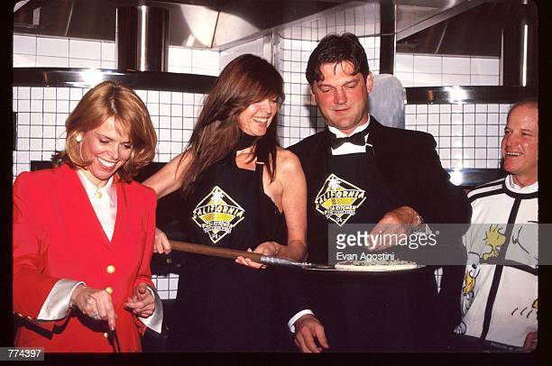 New York Lieutenant Governor Betsy McCaughey model Carol Alt and hockey player Ron Greschner stand in the kitchen at the grand opening of California...