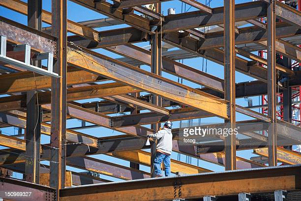 usa, new york, long island city, construction worker on construction frame - long island city stock photos and pictures