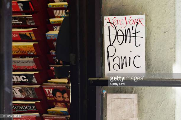 New York Magazine cover reading 'Don't Panic' is displayed on the door of a magazine shop as the coronavirus continues to spread across the United...