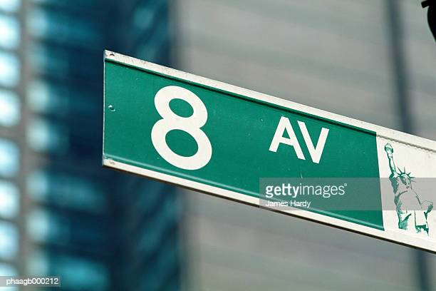 new york, manhattan, 8th avenue street sign, close-up - avenida fotografías e imágenes de stock