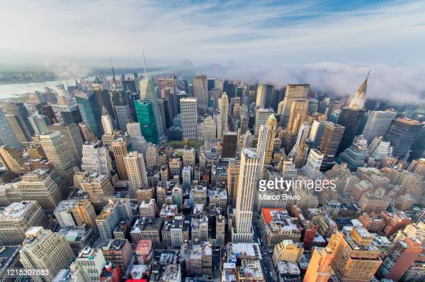 new york. manhattan. aerial view at dusk - marco brivio stock pictures, royalty-free photos & images
