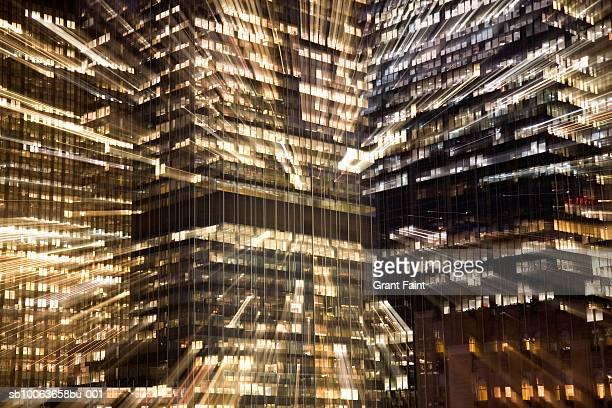 USA, New York, Manhattan buildings at night, zoom effect