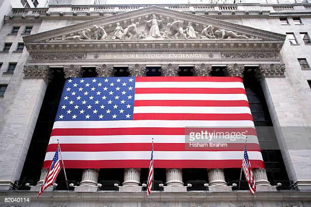 USA, New York, Manhattan Financial District, Wall Street, New York Stock Exchange with American flag across columns