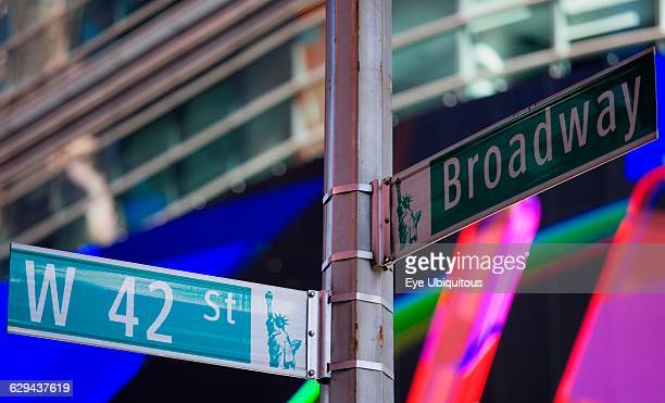 USA New York Manhattan Road signs at the junction of Broadway and 42nd Street in the Theater District