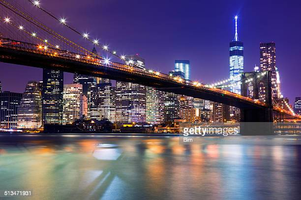 New York, Manhattan Skyline with Brooklyn Bridge at Night