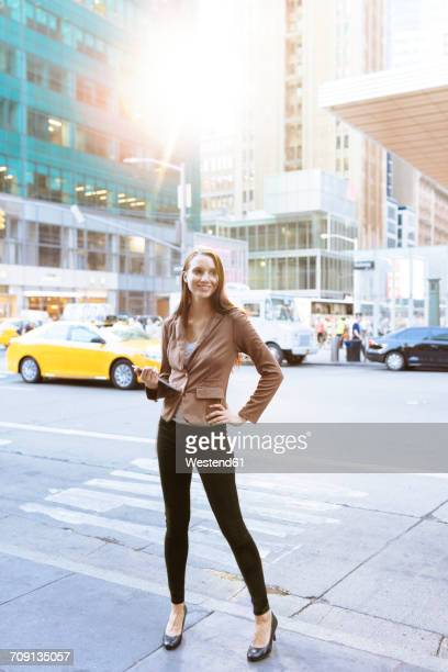 USA, New York, Manhattan, smiling young businesswoman with tablet