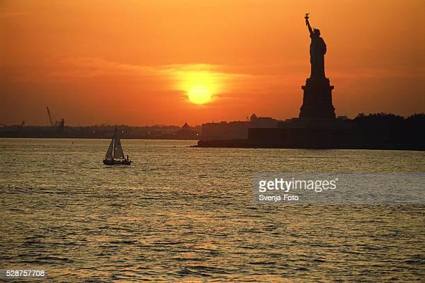 USA, New York, Manhattan, Statue of Liberty at dawn