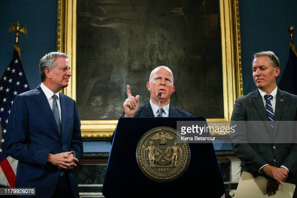New York Mayor Bill de Blasio and and NYPD Chief of Detectives Dermot Shea looks on as NYPD Commissioner James O'Neill speaks during a press...