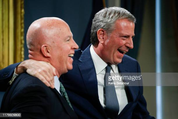New York Mayor Bill de Blasio embraces NYPD Commissioner James O'Neill during a press conference as O'Neill is announcing his resignation on November...