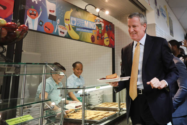 New York Mayor Bill de Blasio joins Schools Chancellor Richard Carranza and school children for lunch at PS130, a Brooklyn public school, for an...