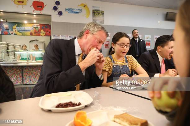 New York Mayor Bill de Blasio joins Schools Chancellor Richard Carranza and school children for lunch at PS130 a Brooklyn public school for an...