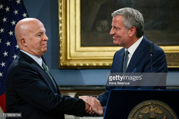 New York Mayor Bill de Blasio shakes hands with to NYPD Commissioner James O'Neill during a press conference as O'Neill is announcing his resignation...