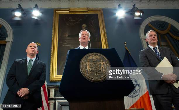 New York Mayor Bill de Blasio speaks next to NYPD Commissioner James O'Neill and NYPD Chief of Detectives Dermot Shea during a press conference as...