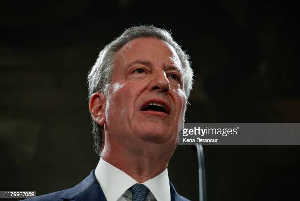 New York Mayor Bill de Blasio speaks next to NYPD Commissioner James O'Neill during a press conference as O'Neill is announcing his resignation on...