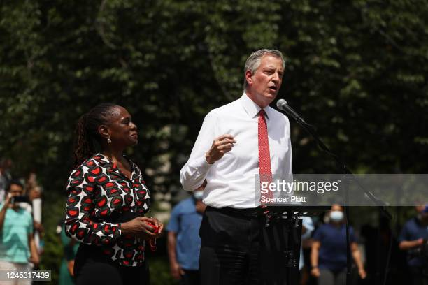 New York Mayor Bill de Blasio speaks to an estimated 10000 people as they gather in Brooklyn's Cadman Plaza Park for a memorial service for George...