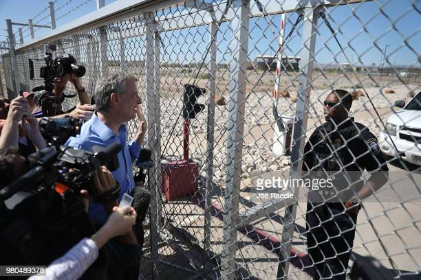 New York Mayor Bill de Blasio speaks with a Department of Homeland Security Police officer as he is told he cannot cross through the gate to the tent...