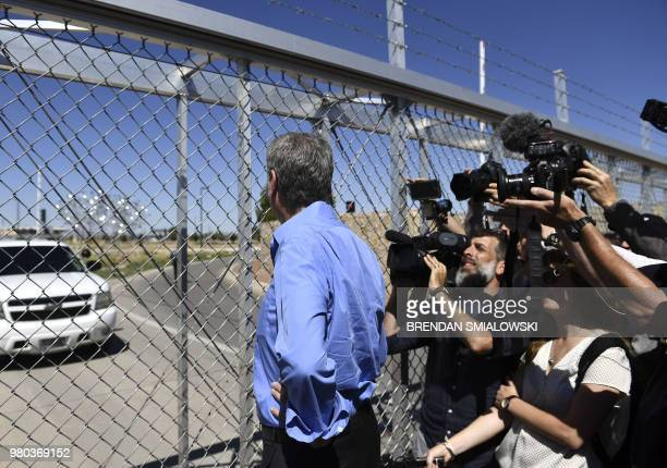 New York mayor Bill de Blasio stands at a fence at the Tornillo Port of Entry near El Paso, Texas, June 21, 2018 during a protest rally by several...