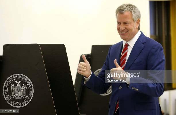 New York Mayor Bill de Blasio votes at a public library in Brooklyn on Election Day on November 7 2017 in New York City De Blasio who is running for...