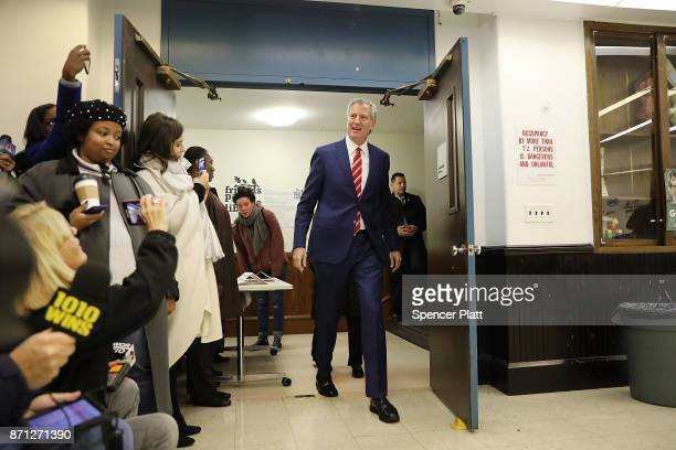 New York Mayor Bill de Blasio walks into his polling site at the Park Slope Library on Election Day on November 7 2017 in the Brooklyn borough of New...