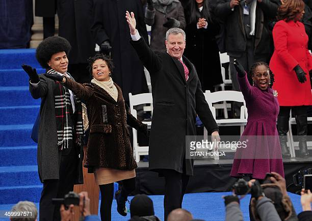 New York Mayor Bill de Blasio waves to the crowd after being sworn in as New York City Mayor on the steps of City Hall in Lower Manhattan on January...