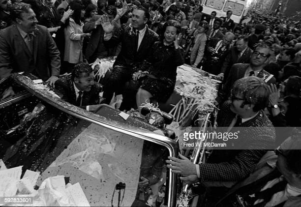 New York Mayor John Lindsay and New York Mets baseball manager Gil Hodges with his wife Joan ride in an opentop convertible during a ticker tape...