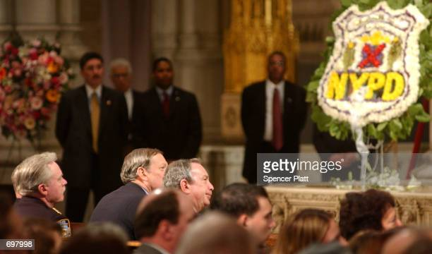 New York Mayor Michael Bloomberg attends the funeral mass for police officer Moira Smith February 14, 2002 at St. Patricks Cathedral in New York...