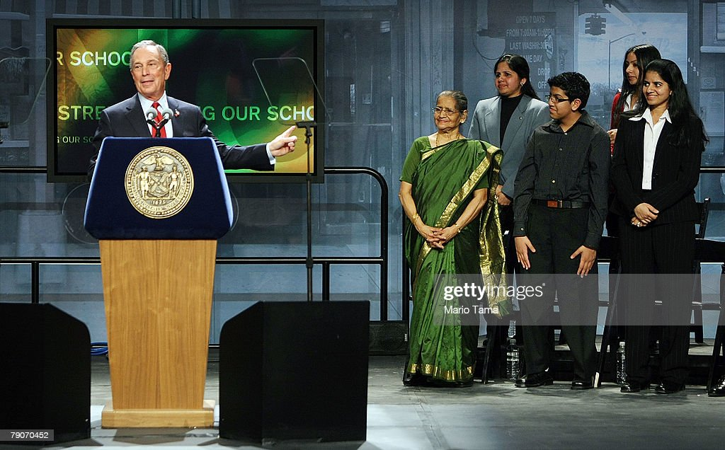 New York Mayor Michael Bloomberg points to the Snreenivasan family, originally from India, while delivering the State of the City address at Flushing Meadows Corona Park January 17, 2008 in the Queens borough of New York City. Bloomberg, who is reportedly considering an independent run at the presidency, derided xenophobic politicians and said immigration and diversity were good for America. Bloomberg spoke against a backdrop of five ethnically diverse families living in Queens.