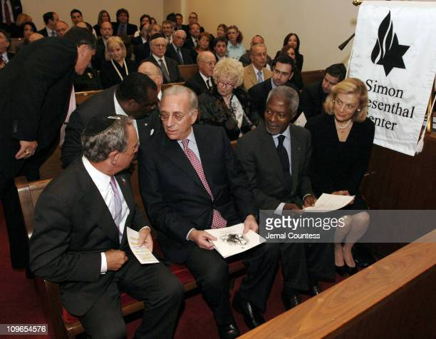 New York Mayor Michael Bloomberg, speaks with Un Secretary General Koffi Annan and wife Nane Annan at the New York Memorial Service for Simon...