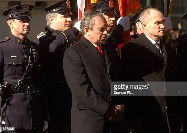New York Mayor Michael Bloomberg stands with Police Commissioner Raymond Kelly at the funeral mass for police officer Moira Smith February 14, 2002...