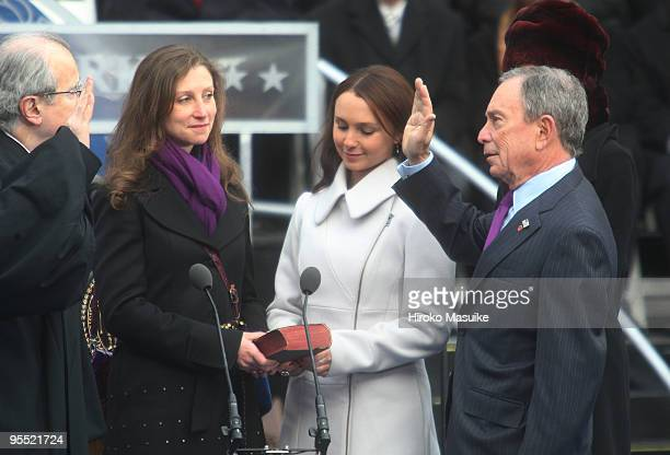New York Mayor Michael Bloomberg takes the oath of office administered by New York State Chief Judge Jonathan Lippman as his daughters Emma Bloomberg...