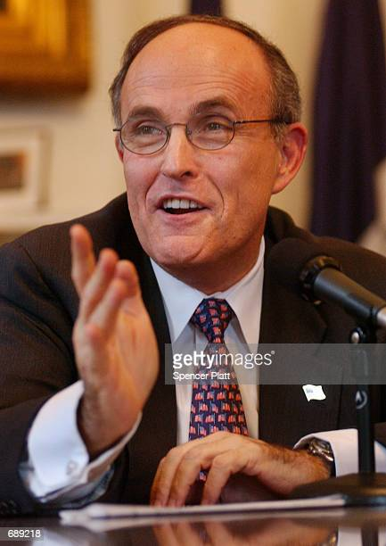New York Mayor Rudolph Giuliani speaks with the press December 28 2001 at City Hall in New York on one of his last days as mayor Giuliani who became...