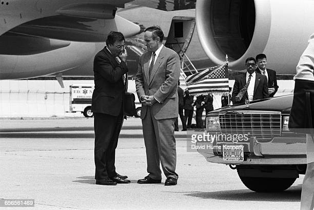 New York Mayor Rudy Giuliani and White House Chief of Staff Leon Panetta await the arrival of President Bill Clinton and First Lady Hillary Clinton...