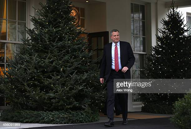 New York Mayorelect Bill de Blasio comes out from the West Wing of the White House to speak to members of the media after a meeting between US...