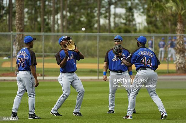 New York Mets' Anderson Hernandez Jose Reyes Victor Diaz and Mike Cameron are on the field as the team works out at the Mets' spring training...