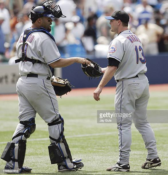 New York Mets Billy Wagner takes the ball from C Ramon Castro after earning his 15th save of the season in the Mets 74 victory vs the Toronto Blue...