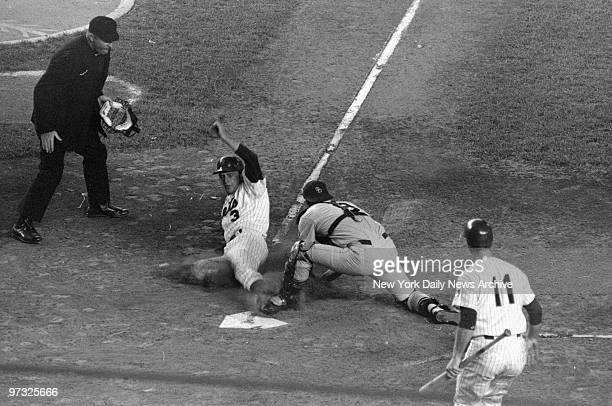 New York Mets' Bud Harrelson slides toward plate in second inning at Shea Stadium but mainly into San Diego Padres' catcher Chris Cannizzaro Plate...