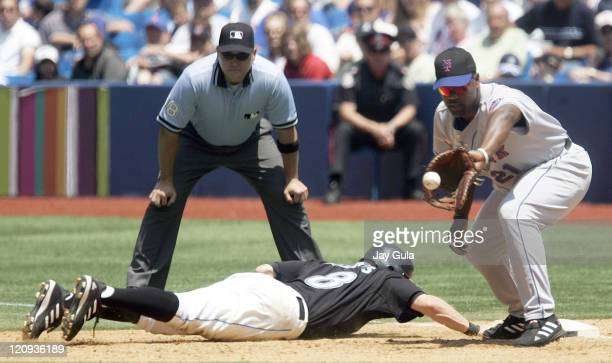 New York Mets Carlos Delgado awaits the throw from P Steve Trachsel but it was not in time to get Toronto Blue Jays Russ Adams in action at Rogers...