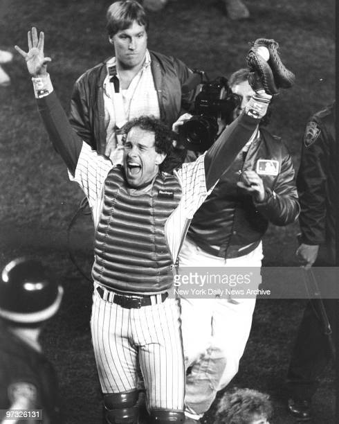 New York Mets' catcher Gary Carter raises his hands in celebration of the Mets 85 victory over the Boston Red Sox in Game Seven of the 1986 World...
