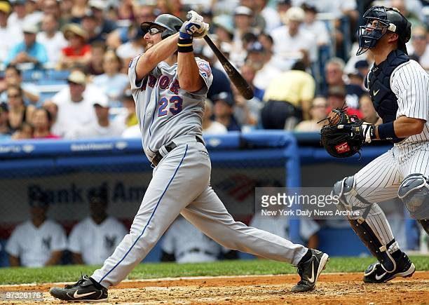 New York Mets' catcher Jason Phillips slugs a sacrifice fly to center field to score Mike Cameron in the second inning of game against the New York...