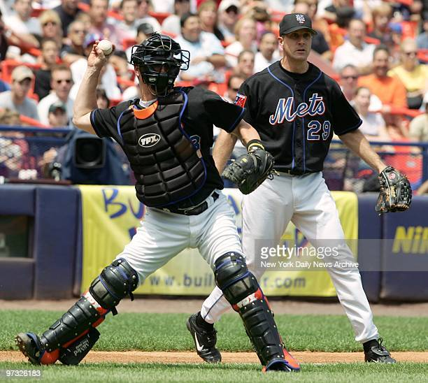 New York Mets' catcher Jason Phillips throws out a runner as pitcher Steve Trachsel looks on in a game against the Atlanta Braves at Shea Stadium....