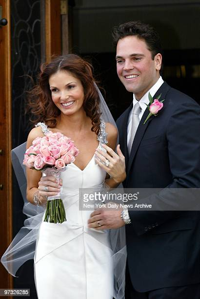 New York Mets' catcher Mike Piazza and his bride Alicia Rickter greet friends and family as they leave St Jude's Catholic Church in Miami after their...